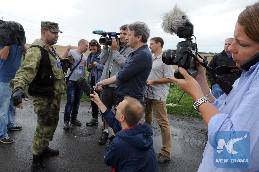 """""""Pro-Russian militant"""" attempts to stop journalists reaching crash site of Malaysia Airlines plane in Ukraine (2014)."""