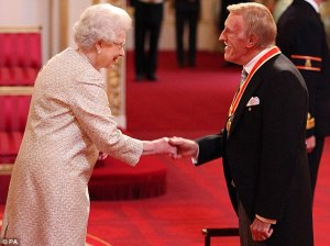Bruce Forsyth being knighted