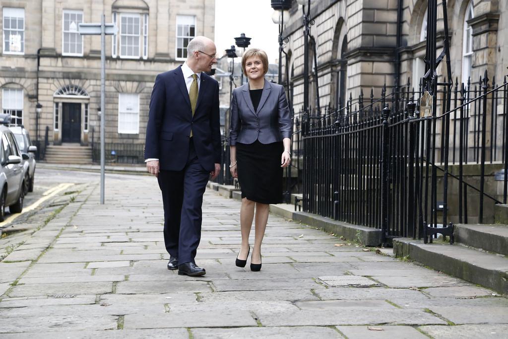 John Swinney and Nicola Sturgeon walking together in Edinburgh outside Bute House