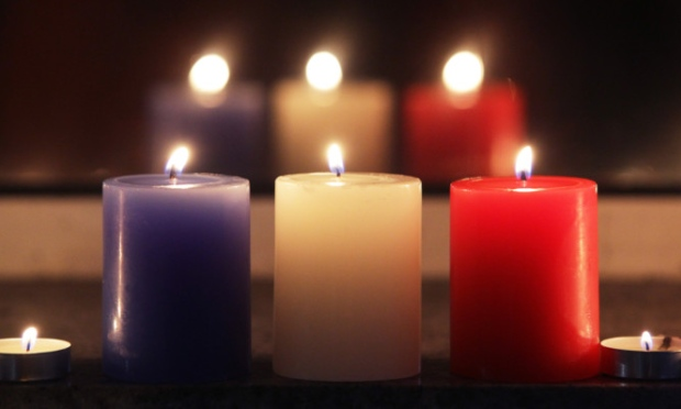 Red, white and blue candles lit in respect of Paris victims.
